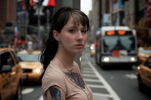 Girl with tattoo on the traffic