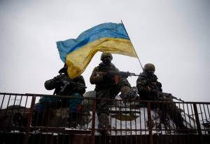 Ukrainian soldiers ride on a military vehicle near Debaltseve in eastern Ukraine on Feb. 16, 2015